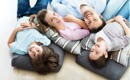Happy family together on the floor Royalty Free Stock Image
