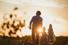 Happy family. Together hand in hand. Sunset Royalty Free Stock Image