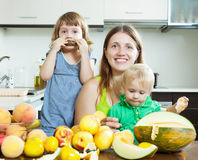 Happy family together with melon Stock Image