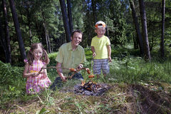 Happy family together near campfire. stock image