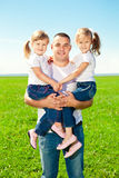 Happy family together in outdoor park  at sunny day. Dad and two Royalty Free Stock Photos