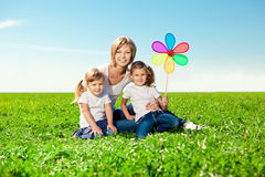 Happy family together in outdoor park  at sunny day. Mom two dau Stock Image