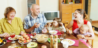 Happy  family  together over celebratory table Royalty Free Stock Images