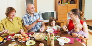 Happy family together over dining table. At home interior Stock Photo