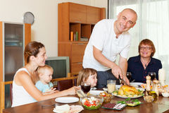 Happy family together over dining table Stock Photos