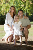 Happy Family Together In A Park Stock Photos