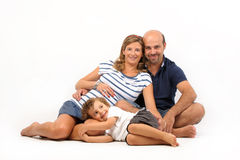 Happy family together with pregnant woman Royalty Free Stock Photos