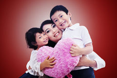 Happy family together on red Royalty Free Stock Photos