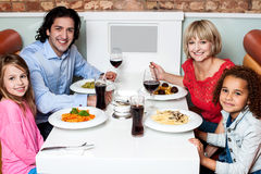 Happy family together in a restaurant Royalty Free Stock Images