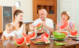 Happy family together with watermelon Stock Images