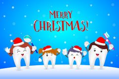 Happy family tooth with Santa hat. Stock Photo