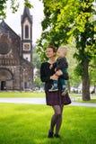 Happy Family of Tourists in park near the Karlin, Karlinske namesti, Prague Royalty Free Stock Photo