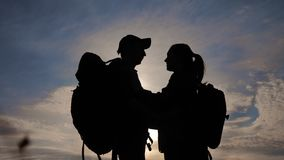 Happy family tourists silhouette at sunset hug kissing. teamwork lifestyle travel concept. man and woman couple with. Happy family tourists silhouette sunset hug stock video footage