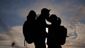 Happy family tourists silhouette at sunset hug kissing. teamwork travel concept. man and woman lifestyle couple with stock video footage