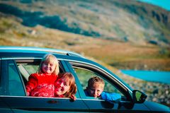 Happy family travel by car in mountains. Happy family- mother with son and daughter- travel by car in mountains stock images