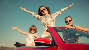 Happy family travel by car in the mountains Stock Images