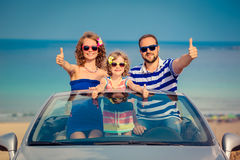 Happy family travel by car. To the sea. People having fun in cabriolet. Summer vacation concept Stock Images