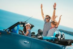 Happy family travel by car to the sea. People having fun in cabriolet. Summer vacation concept stock photography
