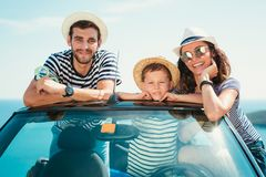 Happy family travel by car to the sea. People having fun in cabriolet. Summer vacation concept royalty free stock photography