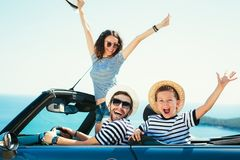 Happy family travel by car to the sea. People having fun in cabriolet. Summer vacation concept stock photo