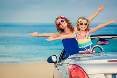 Happy family travel by car. To the sea. Woman and child having fun in cabriolet. Summer vacation concept Stock Photography