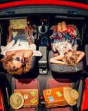 Happy family travel by car. Woman and child having fun in red cabriolet. Summer vacation and travel concept. Top view Royalty Free Stock Photo