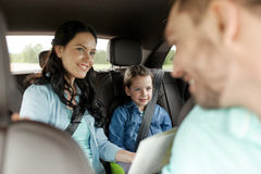 Happy family with travel map driving in car Royalty Free Stock Image