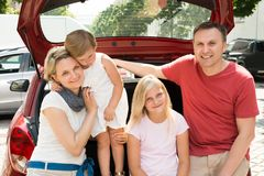 Happy family traveling by car Stock Photography