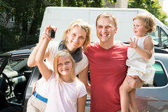 Happy Family Traveling By Car Stock Photo