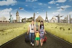 Happy family on the trip to around the world Stock Photos