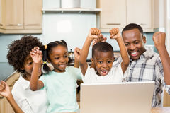Happy family triumphing in the kitchen Royalty Free Stock Image