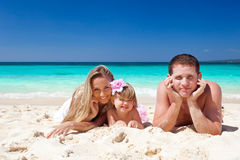 Happy family on tropic vacation Stock Photo