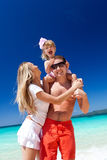 Happy family on tropic vacation Royalty Free Stock Images