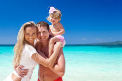 Happy family on tropic vacation Stock Photography