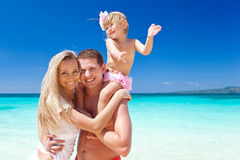 Happy family on tropic vacation Stock Images