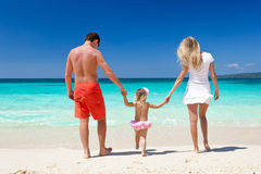 Happy family on tropic vacation Royalty Free Stock Photography