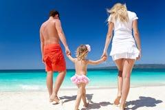 Happy family on tropic vacation Royalty Free Stock Photos