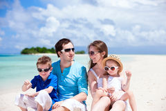 Happy family on tropical beach Royalty Free Stock Image