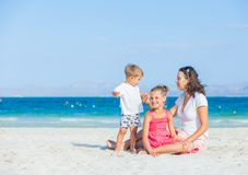 Happy family on tropical beach Stock Photography