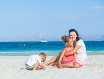 Happy family on tropical beach Stock Images