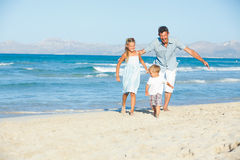 Happy family on tropical beach Royalty Free Stock Photos