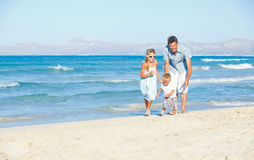 Happy family on tropical beach Royalty Free Stock Images