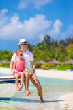 Happy family at tropical beach having fun. Happy father and adorable little daughter at tropical beach having fun Stock Photos