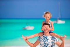 Happy family at tropical beach having fun Stock Image