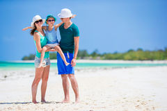 Happy family at tropical beach having fun together. Happy family and adorable little daughter at tropical beach having fun Stock Photography