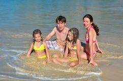 Happy family on tropical beach Stock Photos