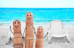 Happy family on the beach. Happy family  on a tropical beach.  Summer Vacation Royalty Free Stock Image