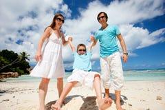 Happy family on tropical vacation Stock Photo