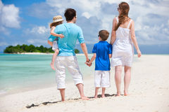Happy family on tropical vacation Stock Photography