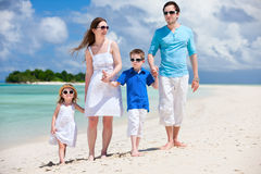 Happy family on tropical vacation Stock Images